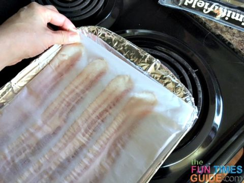 Tuck the edges of the parchment paper under, so the bacon is securely wrapped in a parchment paper envelope.
