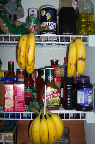 A banana stand made out of the closet shelves in the pantry.