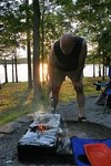 Jim grilling corn on the cob at our campsite -- cooked to perfection too... just seconds away from becoming POPCORN! The crispy brown burn marks were just a bonus... not his fault, we didn't have the proper cooking utensils, and the fire got TOO hot -- thanks to my magic LINT!