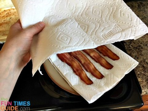 Add few sheets of paper towel on top the bacon to absorb the rest of the grease.