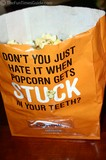 A popcorn bag with a built-in flosser!