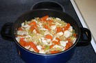Pot of homemade chicken soup on the stove.